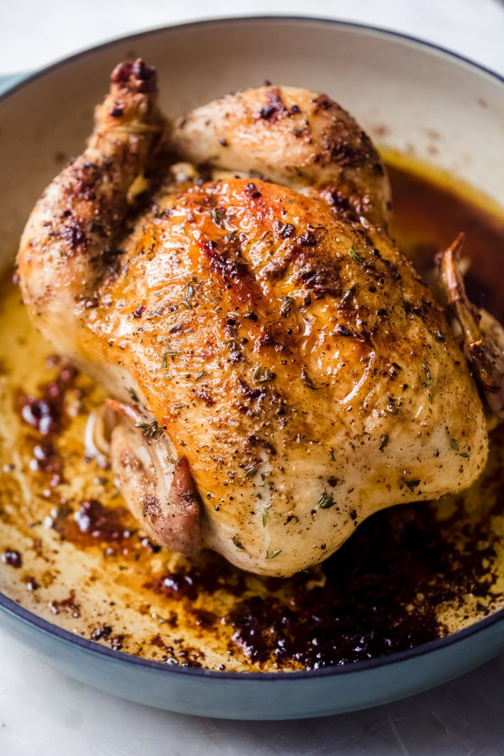 whole roasted chicken in cast iron pan