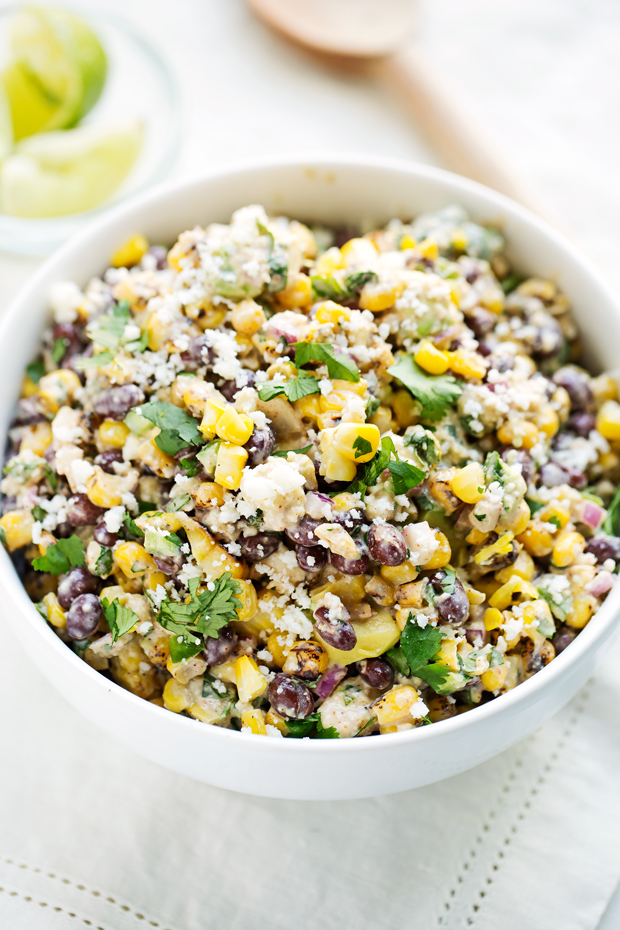 Mexican Street Corn Salad - The perfect summer corn salad with lots of fresh ingredients tossed in a light homemade dressing! #vegetarian #cornsalad #mexicanstreetcorn #streetcornsalad   Littlespicejar.com