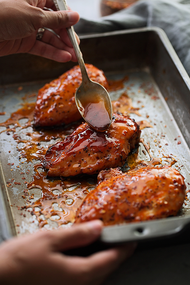Baked Firecracker Chicken - A quick and easy weeknight dinner recipe! Learn how to make my dynamite firecracker sauce. Serve with rice! #bakedchicken #chicken #dinner #firecrackerchicken #firecrackersauce | Littlespicejar.com
