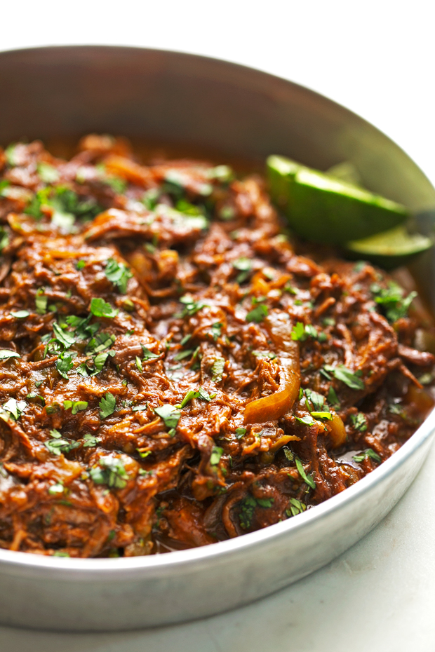 metal baking dish with prepared shredded beef topped with chopped cilantro
