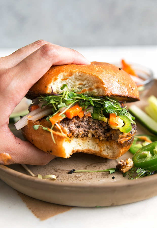 Banh Mi Burgers with Spicy Sriracha Mayo - Homemade burger patties that are juicy and tender topped with all your favorite banh mi fixings! #banhmi #banhmiburger #burgers #pickledveggies #grilling   Littlespicejar.com