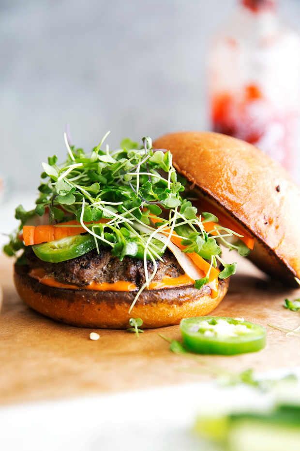 Banh Mi Burgers with Spicy Sriracha Mayo - Homemade burger patties that are juicy and tender topped with all your favorite banh mi fixings! #banhmi #banhmiburger #burgers #pickledveggies #grilling | Littlespicejar.com