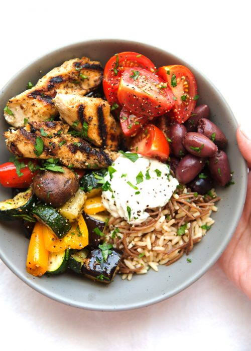 Greek Chicken Souvlaki Bowls with Roasted Vegetables - Simple marinated chicken served in a bowl with roasted veggies and topped with tzatziki sauce. Serve it with rice or pita bread! #mealprep #chickensouvlaki #greekchicken | Littlespicejar.com