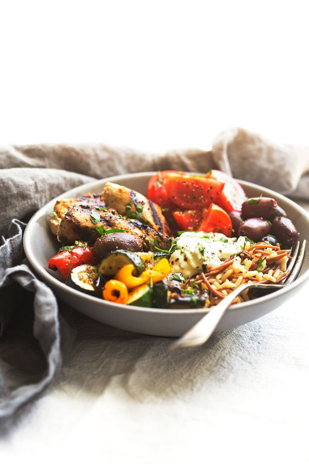 Greek Chicken Souvlaki Bowls with Roasted Veggies - A simple #mealprep meal made with grilled souvlaki chicken tenders, homemade tzatziki sauce, and roasted veggies! SO easy and SO delicious! #greekchicken #grilledchickentenders #chickensouvlakibowls #chickensouvlaki | Littlespicejar.com
