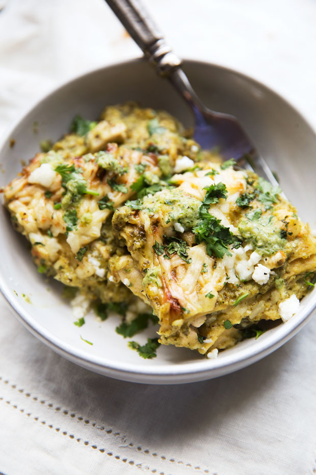 Roasted Tomatillo Chicken Enchilada Pie - A simple homemade tomatillo cream sauce layered in with tortillas and cooked chicken. It's comfort food to the max! #comfortfood #enchiladacasserole #enchiladas #tomatillosalsa   Littlespicejar.com