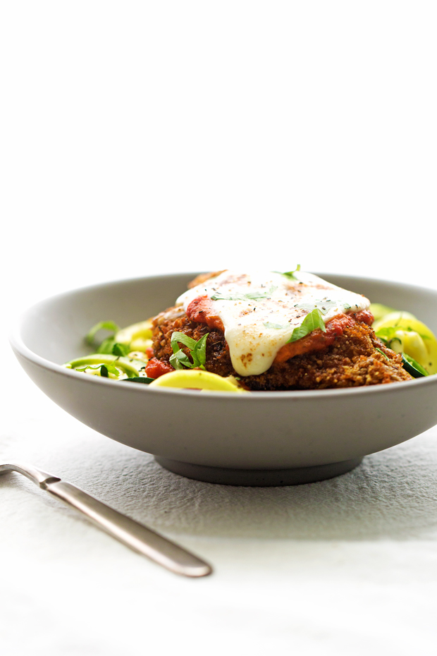 Walnut Crusted Healthy Chicken Parmesan with Zoodles - A healthier take on the chicken parm - we're using walnuts to coat the chicken so it's healthier but still has that crunch! #healthychickenparmesan #walnutcrustedchicken #bakedchicken #chickenparmesan | Littlespicejar.com