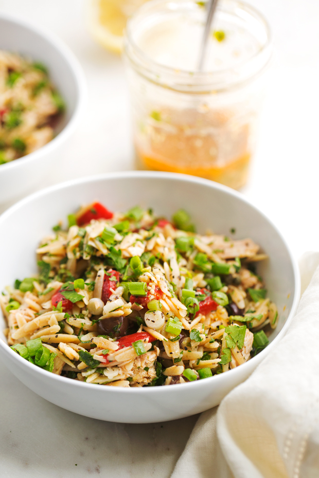 Mediterranean Tuna Orzo Summer Salad - A quick and easy summer salad using mostly pantry ingredients. This salad is hearty and healthy enough to keep you full for hours! Also ideal for #mealprep. #pastasalad #mediterraneansalad #orzosalad #tunasalad   Littlespicejar.com