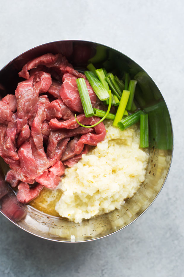 Korean BBQ Bowls with Garlic Scented Rice - Warm, comforting bowls with marinated steak, garlic rice, and a pickled cucumber salad. It's seriously amazing! #koreanbbqbowls #bowls #garlicrice   Littlespicejar.com