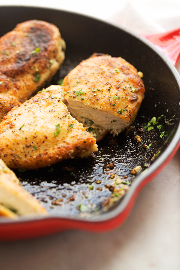 Sun-Dried Tomato and Spinach Stuffed Chicken Breasts - a simple yet elegant recipe for stuffed chicken breasts. Crispy on the outside and cheesy on the inside! #chicken #stuffedchicken #chickenrecipes   Littlespicejar.com