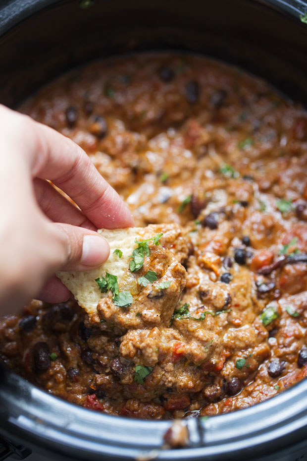 The BEST Cheesy Chili Dip - made with a homemade taco seasoning and NO Velveeta - just simple homemade cheese sauce! So good! #chilicheesedip #cheesychilidip #chilidip   Littlespicejar.com