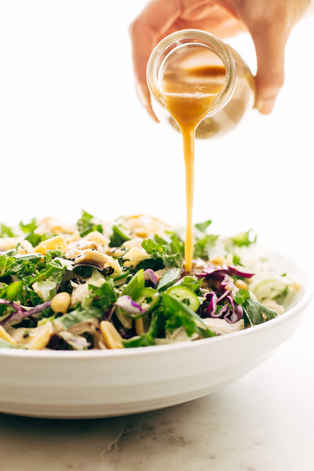 Asian Kale Shaved Brussel Sprout Salad - topped with a homemade ginger miso dressing! It's great to use up leftover greens and shredded turkey or chicken! #asiankalesalad #gingermisodressing #shavedbrusselsproutsalad #salad   Littlespicejar.com