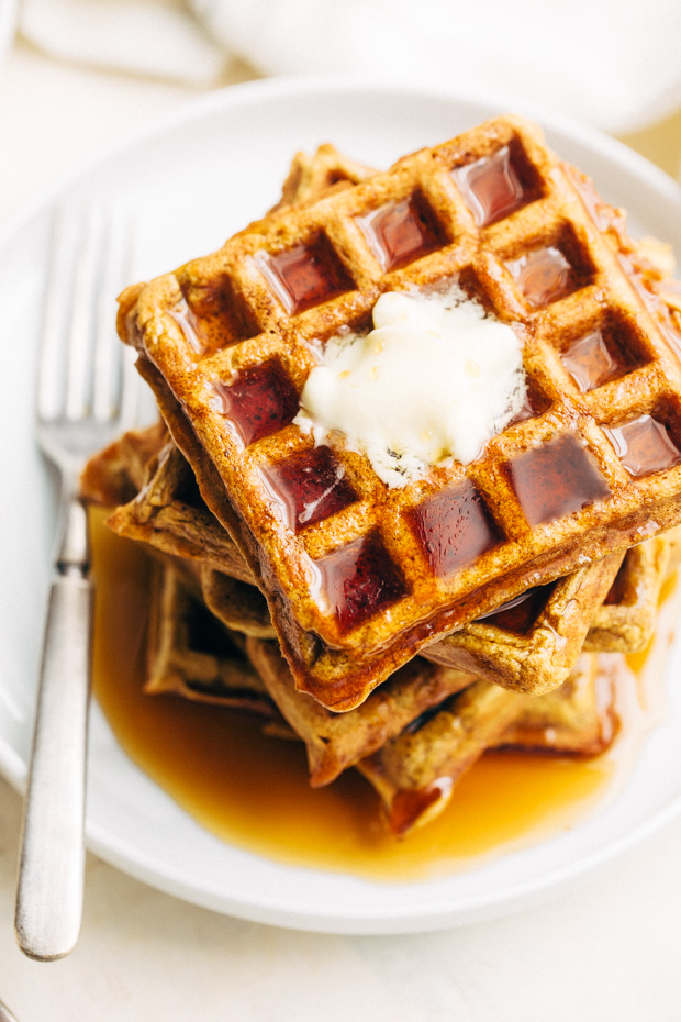 Buttermilk Pumpkin Waffles - The more tender and fluffy waffles that are spiced with fall flavors! Drizzled with maple syrup, they're perfect for fall breakfast! #waffles #pumpkinwaffles #buttermilkwaffles   Littlespicejar.com
