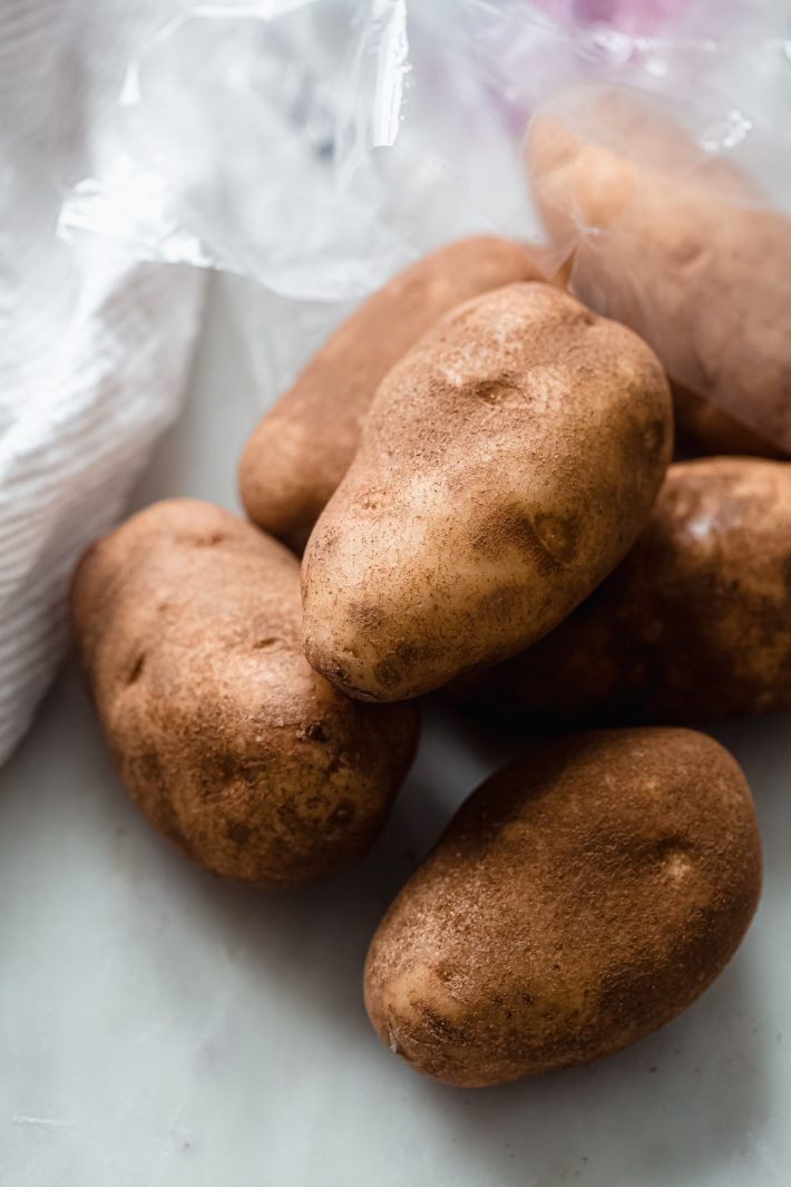 russet potatoes on white marble