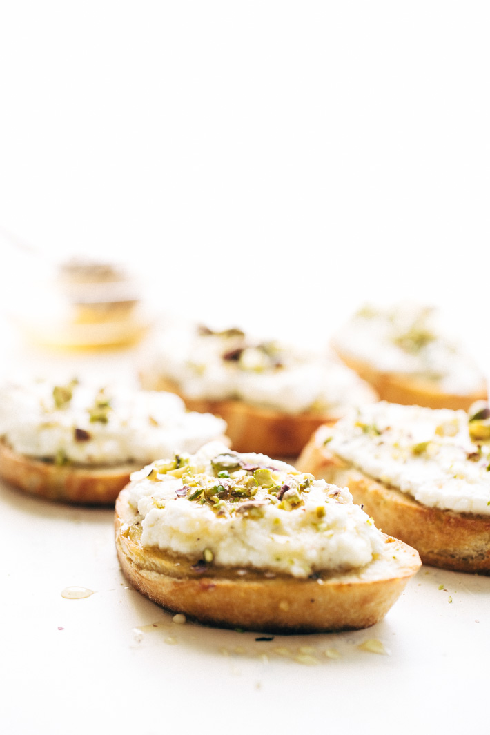 Ricotta Toasts with Pistachios and Honey - A quick and easy appetizer. The bread is warm, the ricotta is creamy, with a kiss of chopped pistachios and a drizzle of honey! #appetizers #toasts #ricottatoasts | Littlespicejar.com