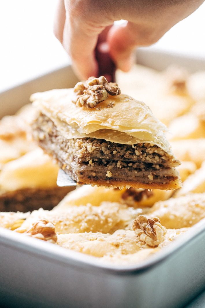 Holiday Walnut Baklava - buttery phyllo with layers of ground walnuts in between and drizzled with a homemade simple syrup with sweet orange blossom and rose water! So good! #baklava #walnutbaklava #lebanesebaklava   Littlespicejar.com