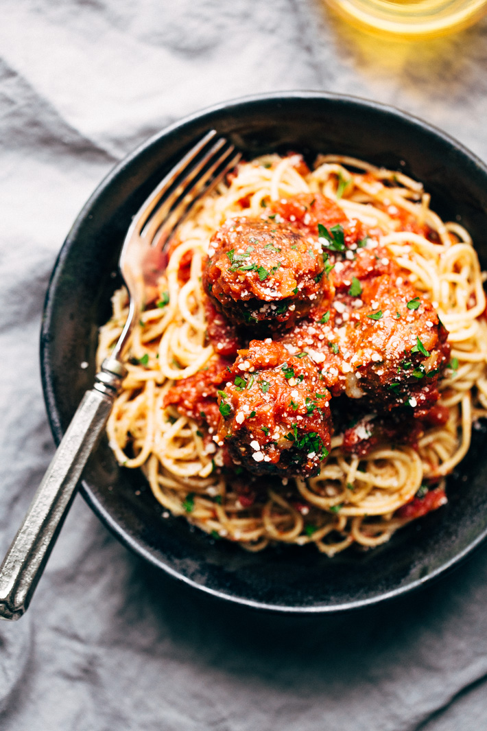 Cheesy Stuffed Meatballs in Homemade Tomato Sauce - The perfect meal for spaghetti and meatball night! Or serve them as party appetizers for New Years, Christmas, and Super Bowl parties! #stuffedmeatballs #cheesestuffedmeatballs #homemadetomatosauce   Littlespicejar.com