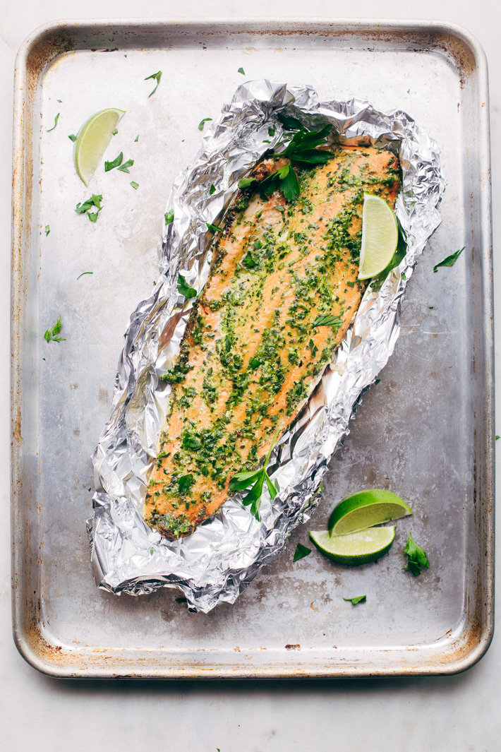 Super Easy Baked Salmon in Foil with Chimichurri Sauce - An easy recipe that takes less than 30 minute to make and is perfect for using on salads or serving with roasted veggies! #bakedsalmon #salmoninfoil #chimichurrisalmon | Littlespicejar.com