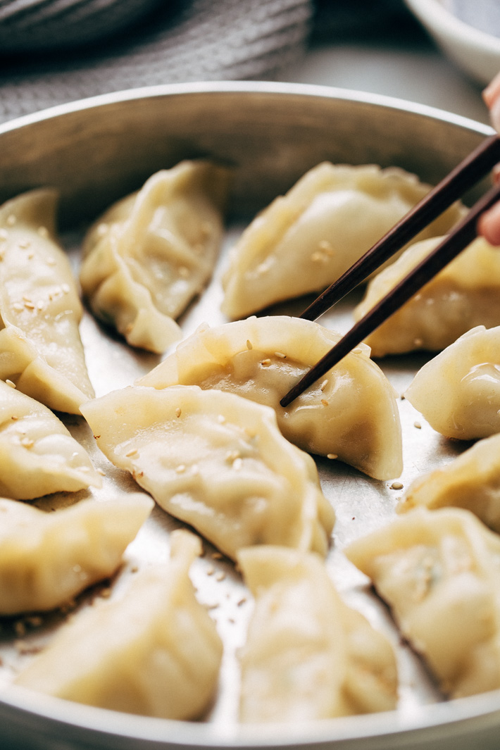 Crazy Good Potstickers with 3-Ingredient Dipping Sauce - The perfect potstickers to make with friends, family, or your significant other on a weekend. The filling is quick and easy to make and these potstickers are so very good! #potstickers #gyoza #jiaozi #wonton | Littlespicejar.com
