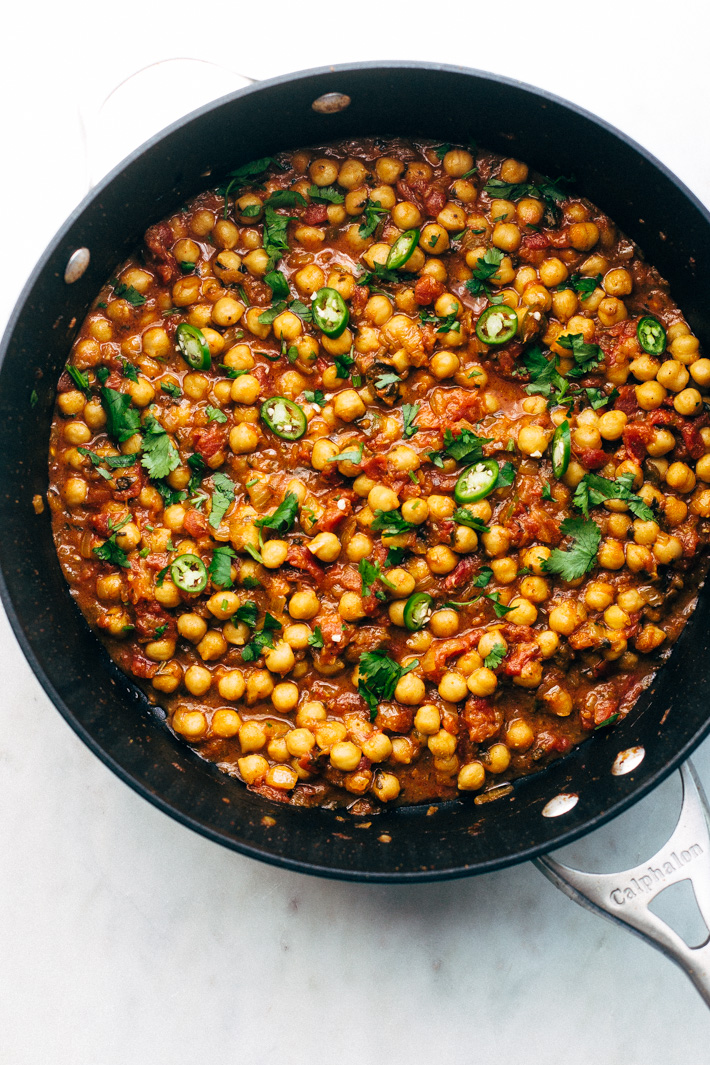 Weeknight Chana Masala Rice Bowls - A quick weeknight take on the traditional Chana Masala! Serve over basmati rice and it's the perfect warm and cozy winter meal! #chanamasala #indianfood #chana #vegan   Littlespicejar.com