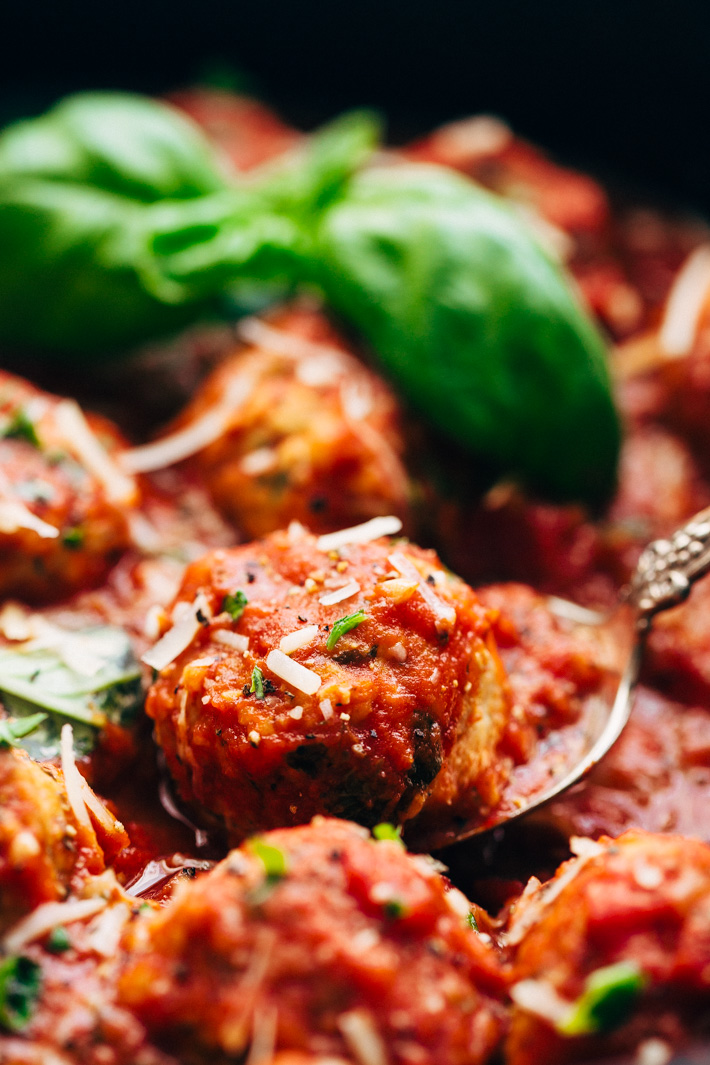 Chicken Parmesan Meatballs and Creamy Polenta - a perfect dish for date night in! These meatballs are flavorful and tender! Serve over parmesan polenta or spaghetti! #chickenparmesan #chickenparmesanmeatballs #polenta #chickenmeatballs #meatballs   Littlespicejar.com