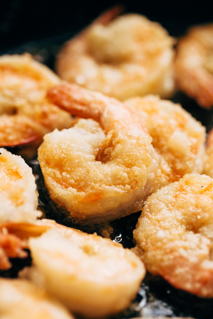 Lighter Honey Walnut Shrimp - A lighter take on the takeout classic! We're pan frying the shrimp in just a hint of oil, tossing it together with candied walnuts and a creamy sauce then serving it over a big mound of greens and rice! #honeywalnutshrimp #takeoutfakeout #walnutshrimp #shrimp | Littlespicejar.com