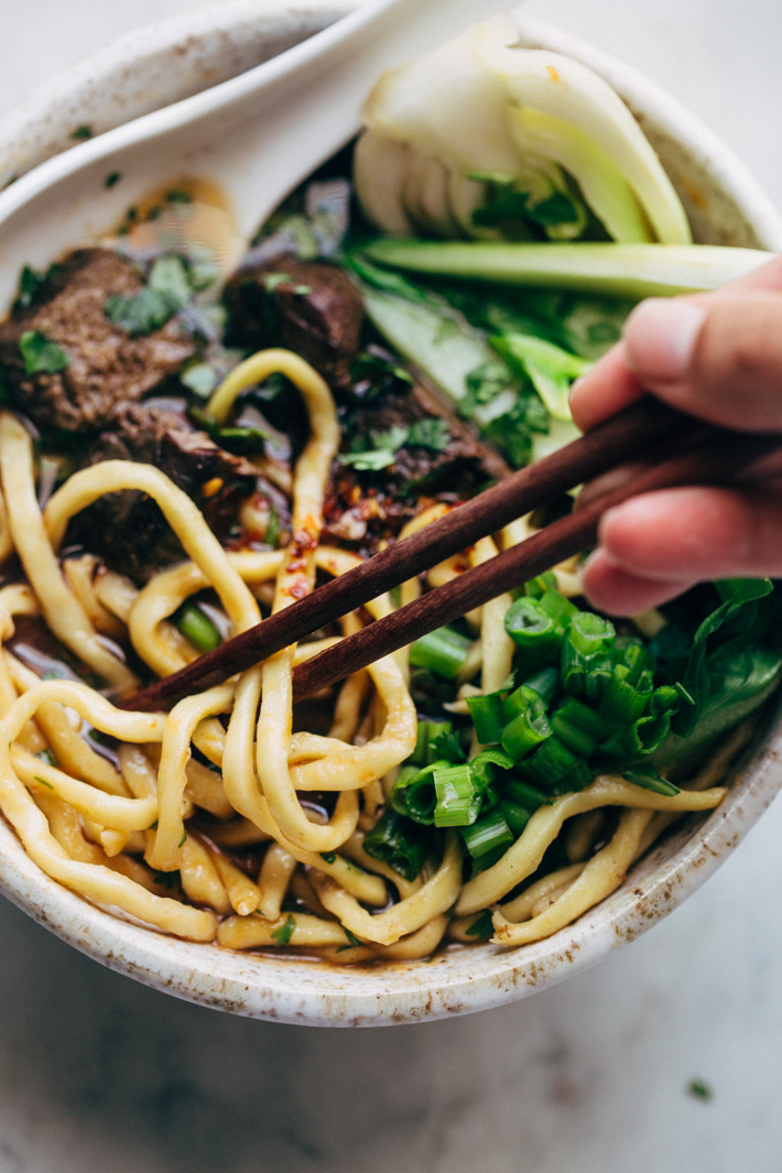 Comfy Cozy Taiwanese Beef Noodle Soup - thick and chewy noodles in a homemade. slow simmered broth with tons of tender beef and fresh greens! #beefnoodlesoup #beefsoup #taiwanesebeefnoodlesoup #asiannoodlesoup | Littlespicejar.com