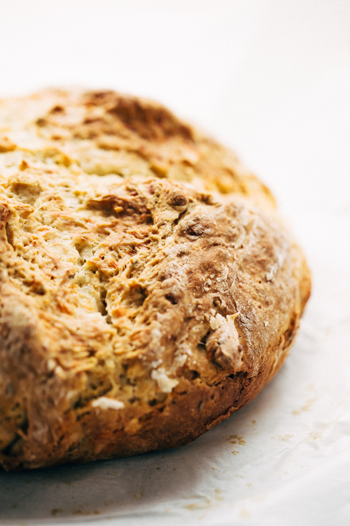 Easy Caraway and Cheddar Irish Soda Bread - bread made with just a few ingredients! Ready in less than an hour and speckled with caraway seeds and cheddar cheese! #irishbread #sodabread #irishsodabread #quickbread #nokneadbread | Littlespicejar.com