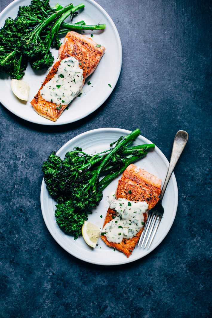 Perfect Pan Seared Salmon with a 4 Ingredient Lemon Butter Cream Sauce! This sauce is DYNAMITE or just about any kind of seafood! #pansearedsalmon #lowcarb #highprotein #salmon #lemonbuttersauce | Littlespicejar.com