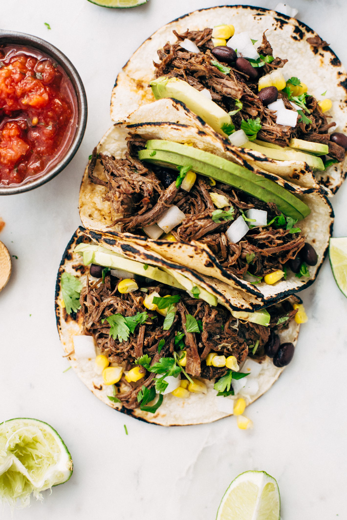 Pressure Cooker Barbacoa Beef - Just sear the meat and pop it all into your pressure cooker and in 1 hour you have the most delicious shredded beef that tastes like you cooked it all day long! #beefbarbacoa #barbacoabeef #instanpot #pressurecooker | Littlespicejar.com