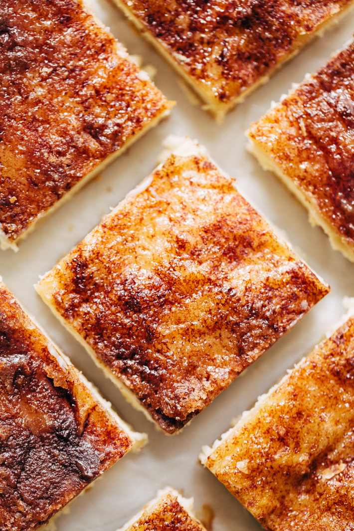 The Most Addicting Sopapilla Cheesecake Bars made with just 8 simple ingredients! These bars don't use the crescent roll dough! #sopapillacheesecakebars #cheesecake #cheesecakebars #snickerdoodle   Littlespicejar.com