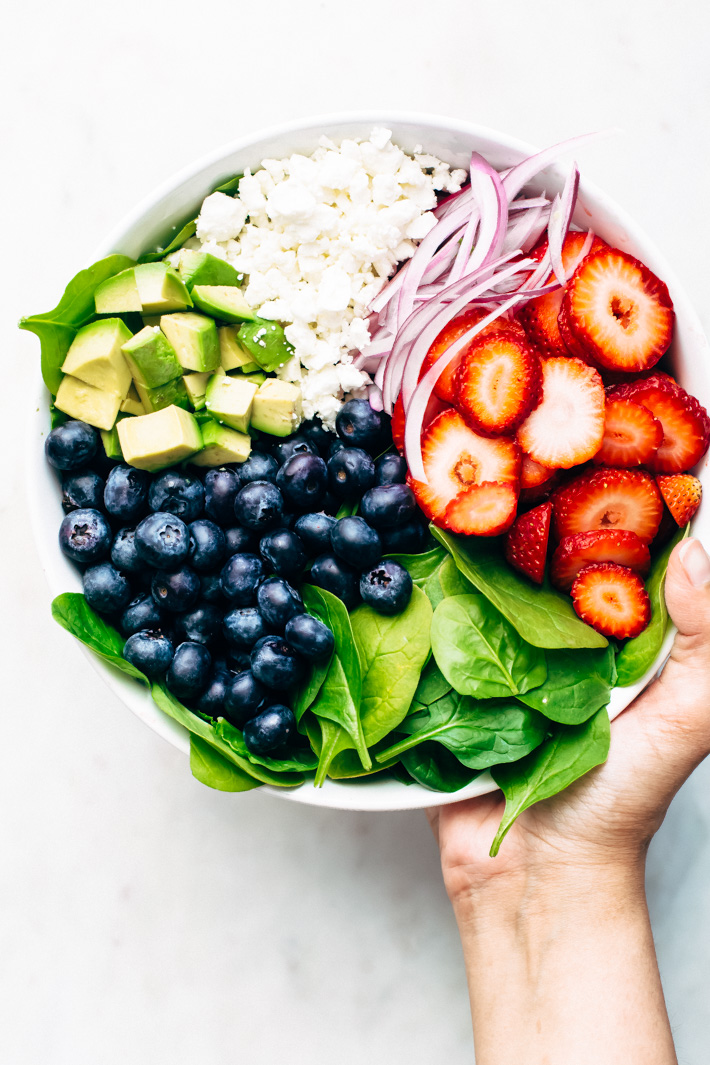 Avocado Strawberry Spinach Salad - topped with a citrusy poppyseed dressing. This salad is perfect for summer barbecues and picnics! #strawberryspinachsalad #spinachsalad #salad #strawberrypoppyseedsalad   Littlespicejar.com