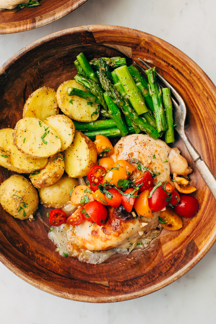 Sheet Pan Bruschetta Chicken with Potatoes and Asparagus - make a healthy, nutritious dinner all on one sheet pan! #bruschettachicken #roastedchicken #chickenbreast #bruschetta | Littlespicejar.com