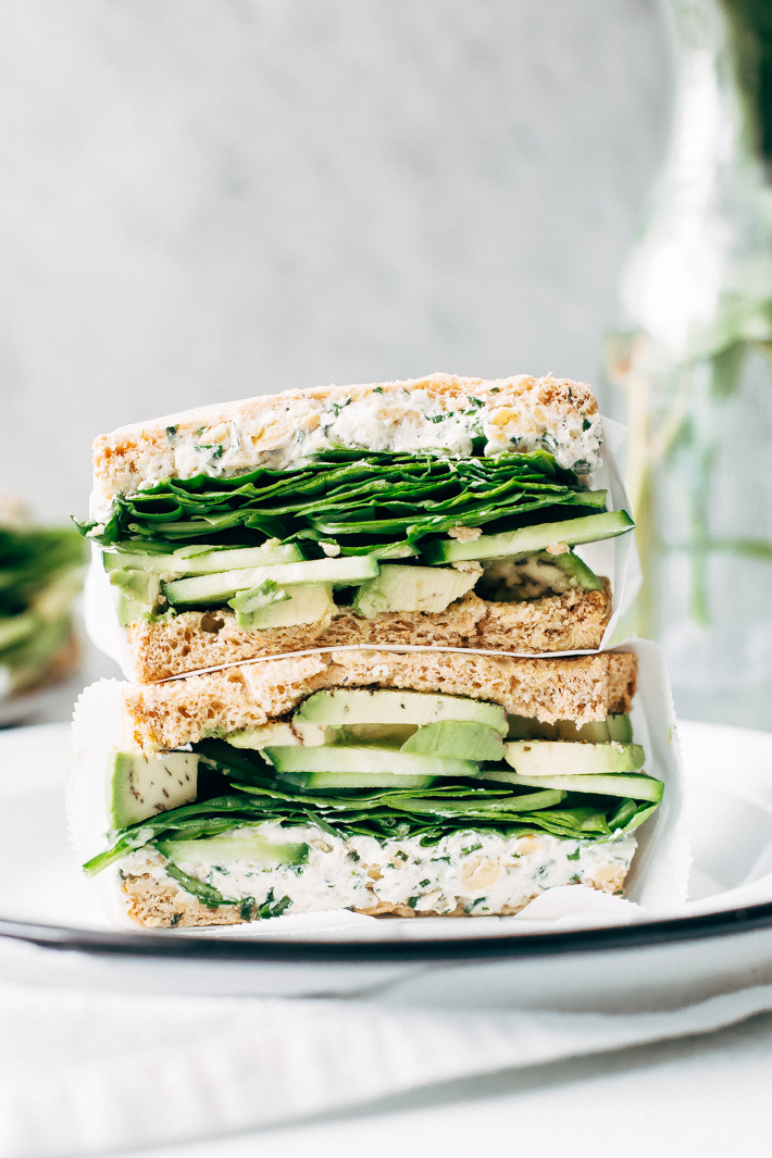 Smashed Chickpea Green Goddess Sandwich - herbed goat cheese and smashed chickpeas loaded between two slices of bread with all your favorite green veggies. This is the perfect lunch! #greengoddesssandwich #sandwich #smashedchickpea #chickpeas | Littlespicejar.com