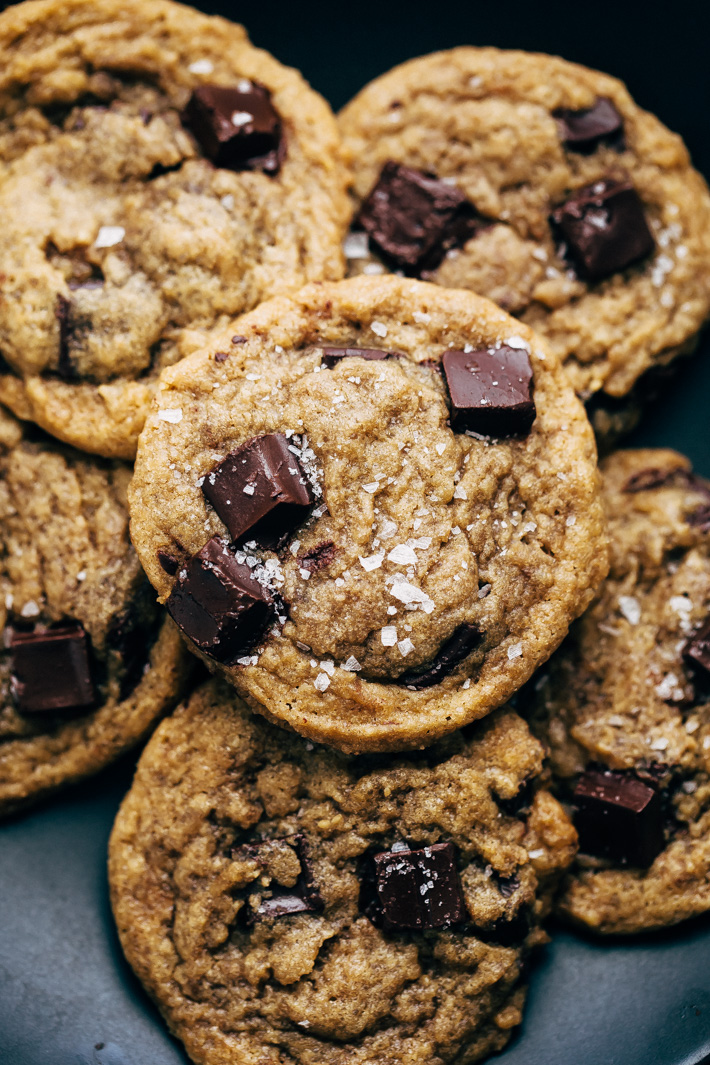 close up of chocolate chunk cookies on a black plate