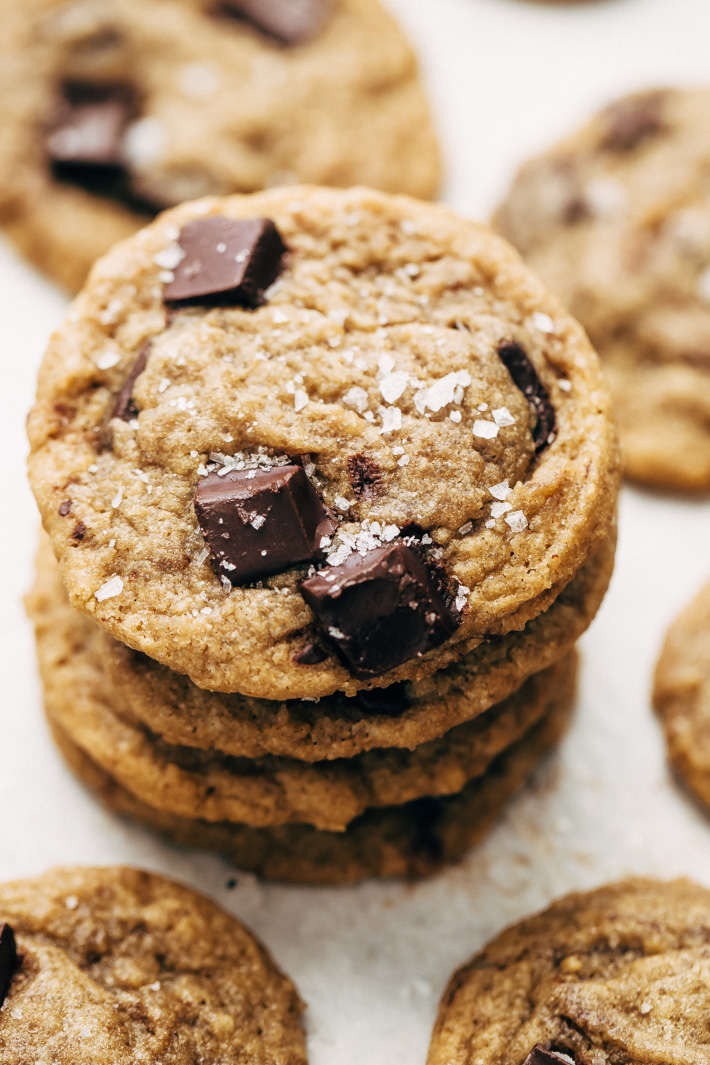 Stack of chewy chocolate chunk cookies with a sprinkle of Maldon salt