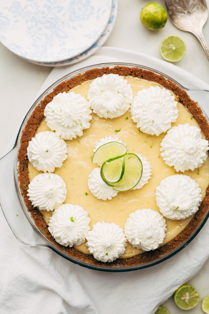 Summertime Key Lime Pie - A completely homemade sweet and tart key lime pie with the most delicious graham cracker crust! This pie is perfect to take to all your summer gatherings! #keylimepie #grahamcrackercrust #pie #4thofjuly | Littlespicejar.com
