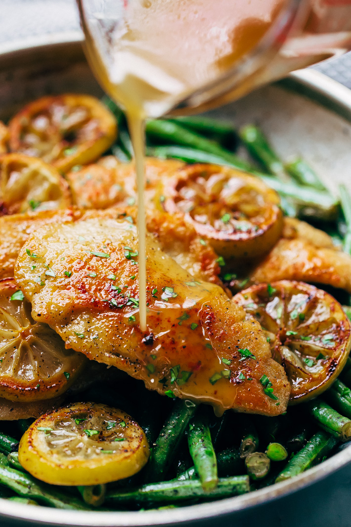 Honey Lemon Chicken with Sautéed Green Beans - simple seared chicken and sautéed green beans drizzled in homemade honey lemon butter sauce. This takes 30 minutes from start to finish and is weeknight friendly! #honeylemonchicken #lemonchicken #chickendinner   Littlespicejar.com
