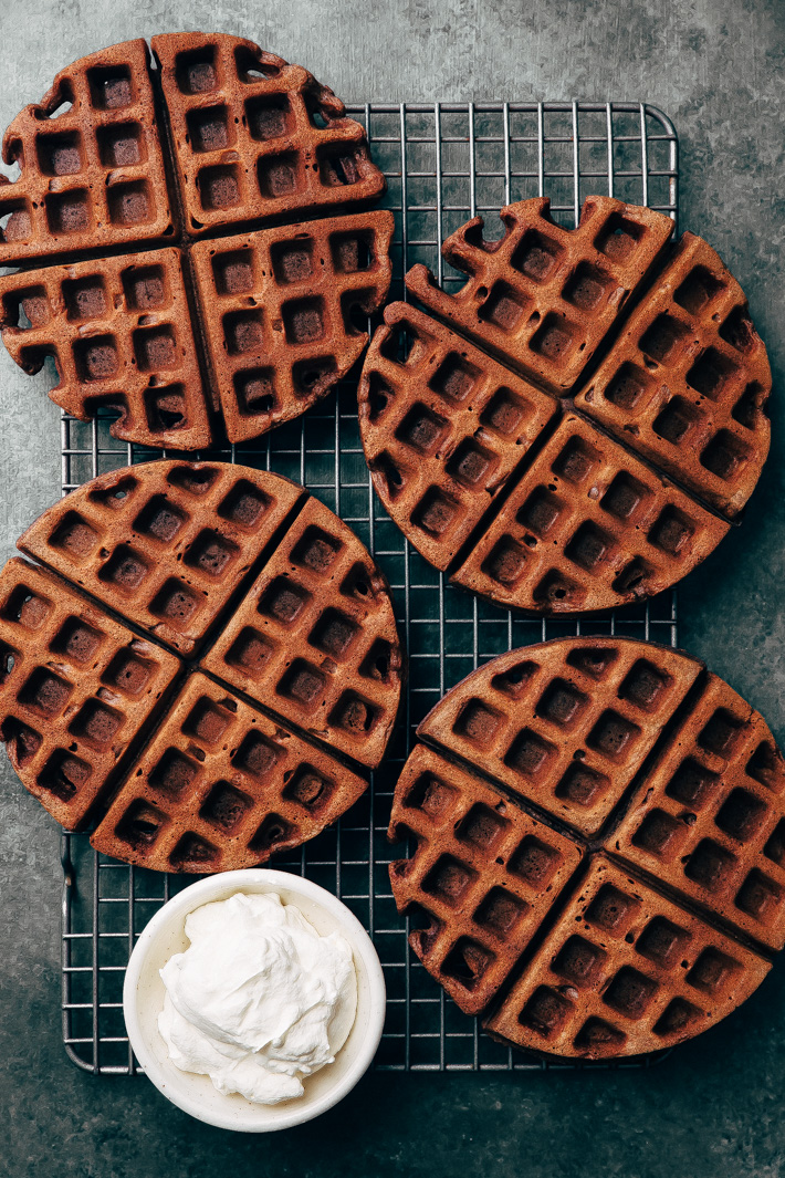 Bomb-Diggity Chocolate Waffles - These waffles are tender on the inside and crispy on the outside. Lightly sweetened so you can have them for breakfast or add a scoop on ice cream and turn them into waffle ice cream sandwiches! #browniewaffles #cakewaffles #chocolatewaffles #chocolatecakewaffles | Littlespicejar.com