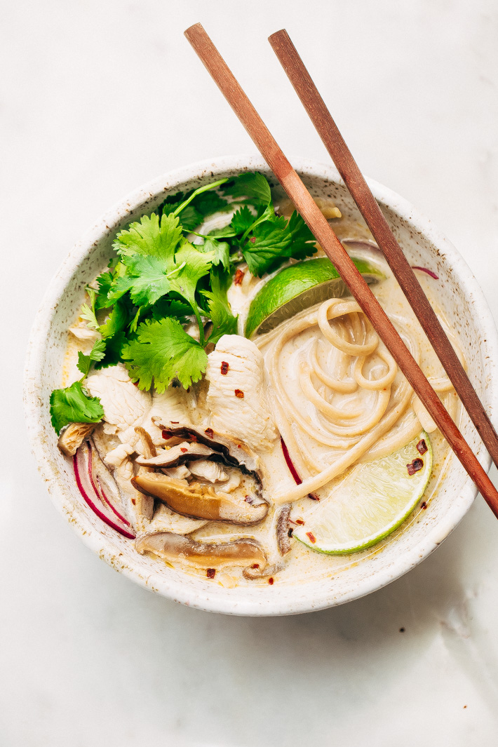 Creamy Comforting Chicken Coconut Noodle Soup - A Tom Kha Gai soup meets an American classic - chicken noodle. This soup is rich and comforting! #tomkhagai #thaisoup #coconutnoodlesoup #chickennoodlesoup | Littlespicejar.com