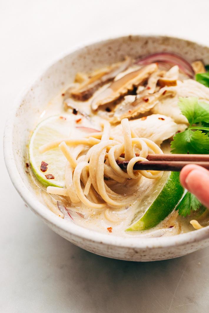 Creamy Comforting Chicken Coconut Noodle Soup - A Tom Kha Gai soup meets an American classic - chicken noodle. This soup is rich and comforting! #tomkhagai #thaisoup #coconutnoodlesoup #chickennoodlesoup   Littlespicejar.com