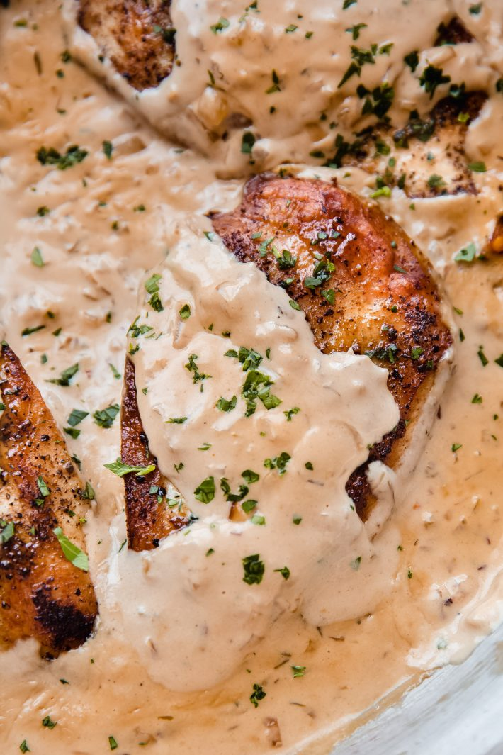 close up of chicken breast in balsamic onion cream sauce