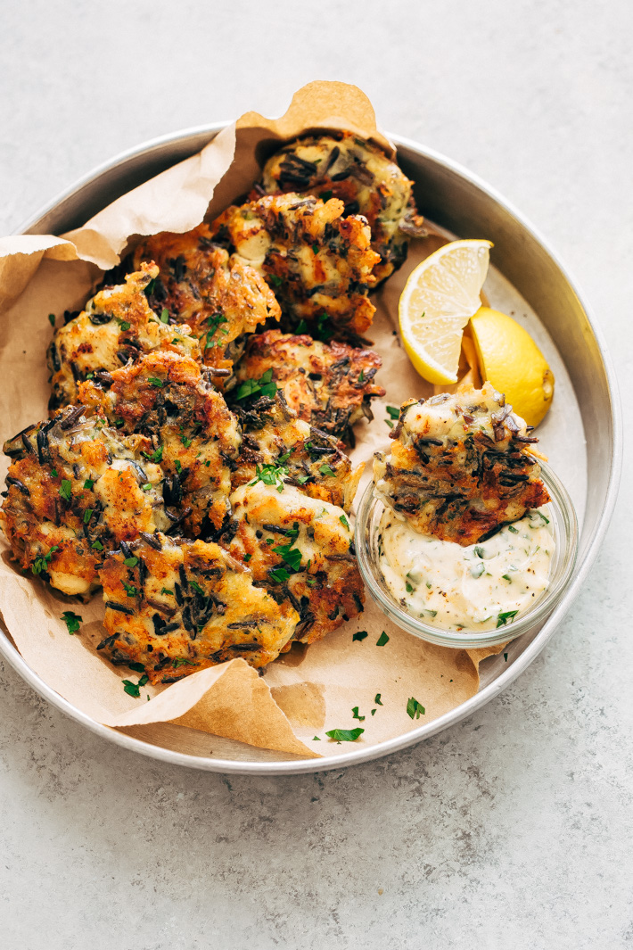 Cheesy Wild Rice Chicken Fritters - the perfect two-bite appetizers for holiday get togethers. Make them larger and serve them between buns or on a salad too! #appetizers #chickenfritters #fritters #holidayappetizers | Littlespicejar.com