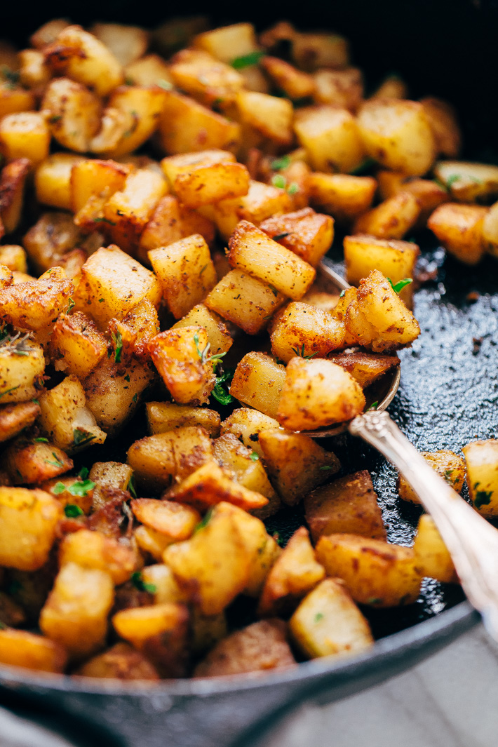 Easy Skillet Breakfast Potatoes - lightly crispy on the outside, tender on the inside. These breakfast potatoes are sure to be a hit! #skilletpotatoes #breakfastpotatoes #crispypotatoes | Littlespicejar.com