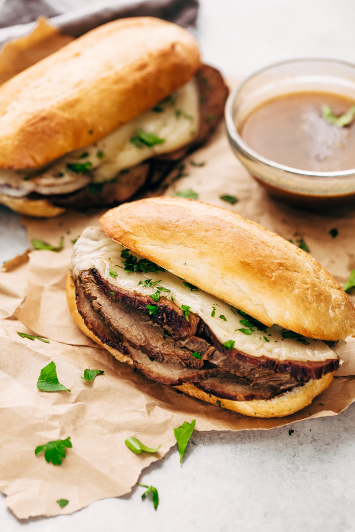 Slow Cooker French Dip Sandwiches - Tender beef that's slow cooked in au jus. These sandwiches are to die for! #frenchdip #frenchdipsandwich #frenchdipsandwiches #slowcooker #crockpot   Littlespicejar.com