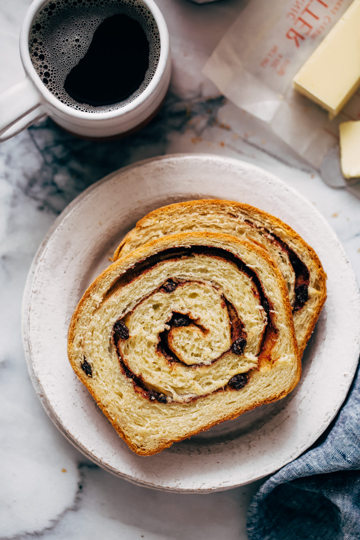 Homemade Cinnamon Swirl Bread - swirls of cinnamon sugar and raisins (or chocolate chips). Perfect to serve smeared with butter or to turn into french toast! #cinnamonbread #cinnamonswirlbread #swirlbread #cinnamonsugarbread | Littlespicejar.com