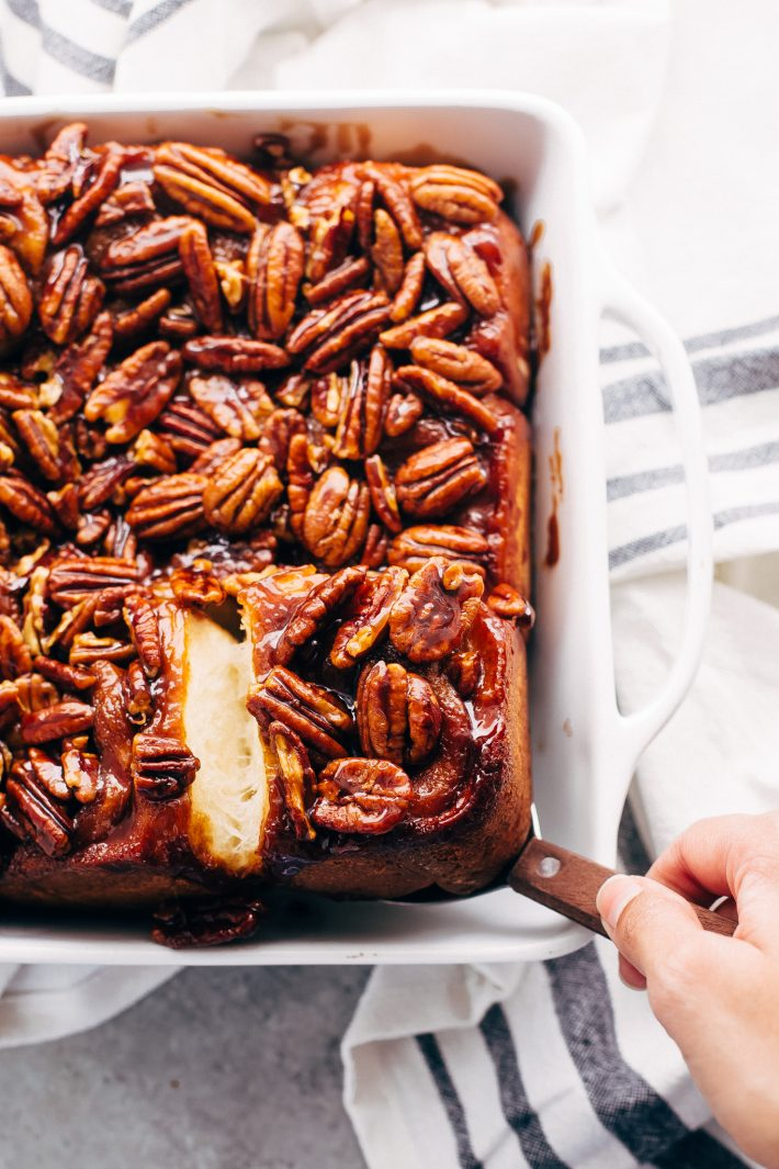 Gooey Pecan Sticky Buns - Learn how to make sticky buns at home from scratch. These sticky buns have a caramel pecan topping and swirls of cinnamon inside! #stickybuns #maplepecanstickybuns #pecanstickybuns #cinnabon #cinnamonrolls   Littlespicejar.com