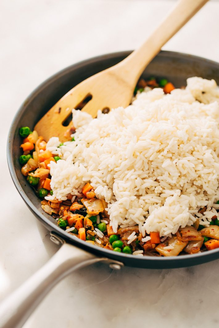 Quick Kimchi Fried Rice - Learn how to make quick and easy kimchi fried rice! Perfect to use up leftover rice! #kimchi #kimchifriedrice #friedrice #veggiefriedrice   Littlespicejar.com
