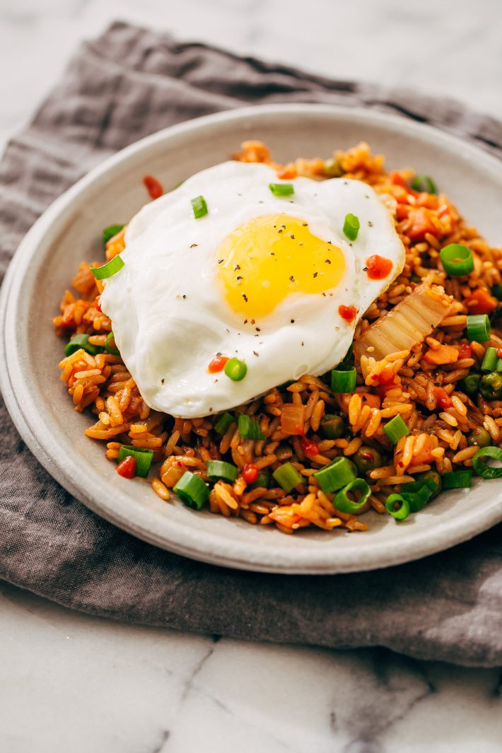 Quick Kimchi Fried Rice - Learn how to make quick and easy kimchi fried rice! Perfect to use up leftover rice! #kimchi #kimchifriedrice #friedrice #veggiefriedrice | Littlespicejar.com