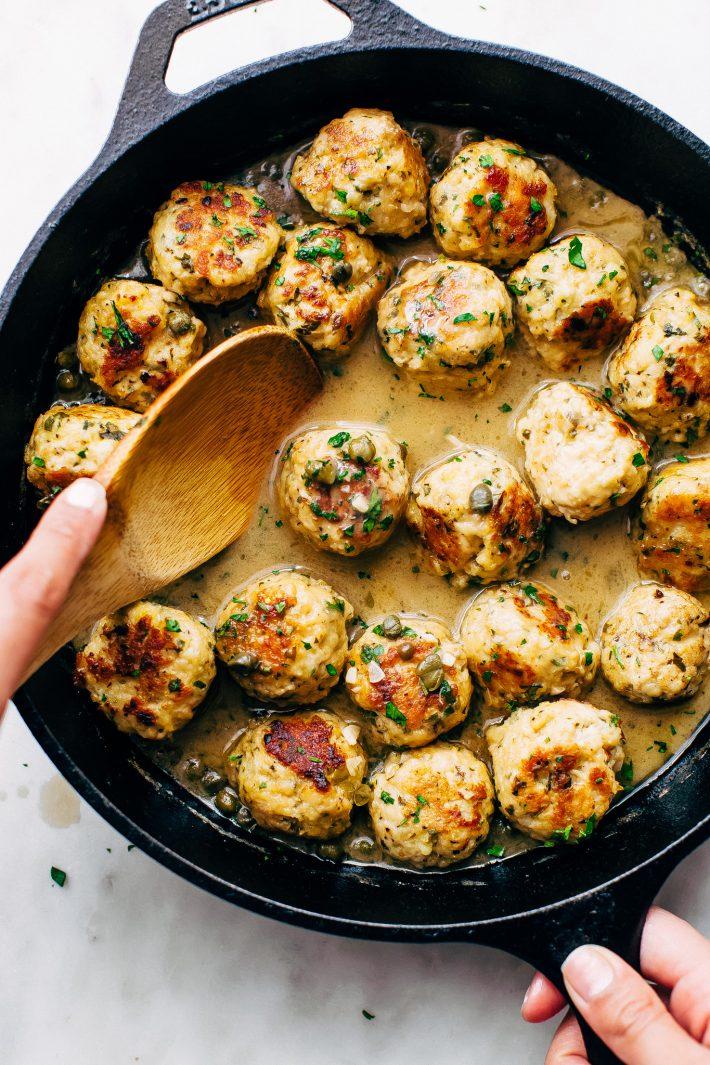 Rustic Chicken Piccata Meatballs - tender chicken meatballs in golden piccata sauce. Serve over rice, quinoa, pasta, or with crusty bread! #chickenpiccata #chickenpiccatameatballs #chickenmeatballs #meatballs | Littlespicejar.com