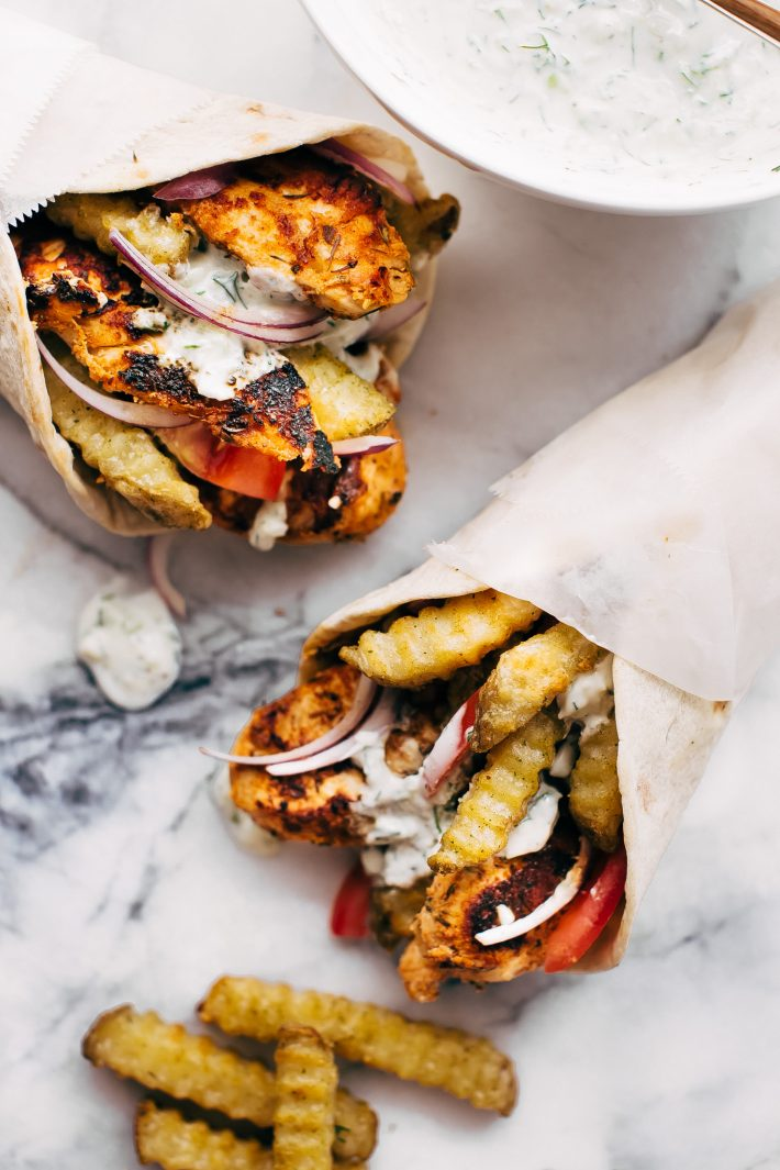 Easy Chicken Gyros with French Fries and Tzatziki Sauce - Learn how to make the easiest chicken gyros! Perfect for weeknight dinners! #chickengyros #gyros #gyrosrecipe #greekchicken   Littlespicejar.com